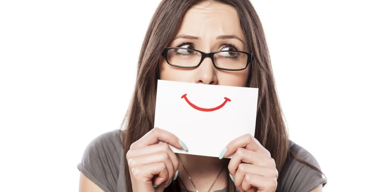 14533-woman-fake-smile-mask-happy-sad-wide-1200w-tn_