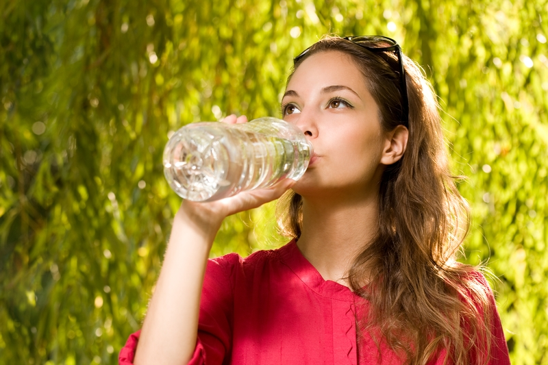 s-women-drinking-water-from-bottle-outside
